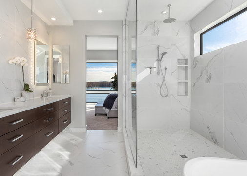 Beautiful master bathroom interior in new luxury home with walk-in shower and double vanity