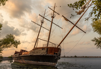 Canvas Prints Ship Abandoned pirate ship in jordan harbour, ontario at sunset with clouds in the background