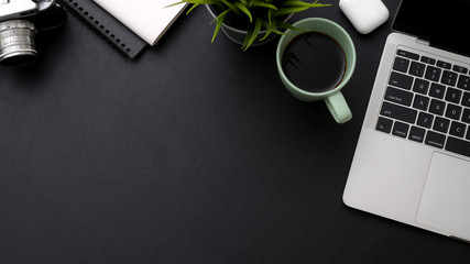 Wall Mural - Top view of workspace with laptop, coffee cup, notebooks and copy space