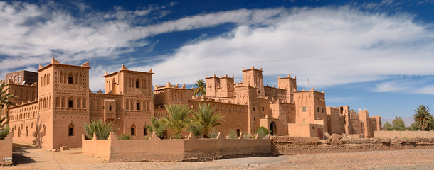 Spoed Fotobehang Marokko Panorama of Kasbah Amerhidil on a dry river bed in the Skoura oasis Palm Grove Morocco
