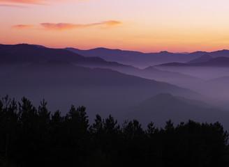 Tuinposter Aubergine Sunset over the mountains in the Aiako Harriak Natural Park, Euskadi