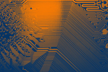 Blue and orange electronic mother board circuit close up macro background.