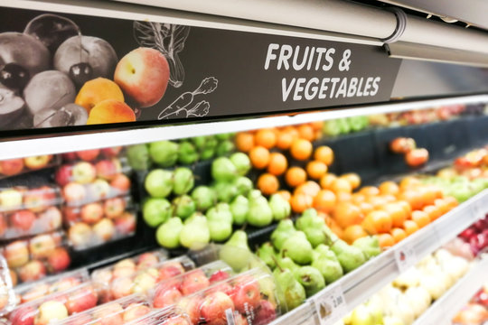 Fruits and Vegetable signage at supermarket with defocused background