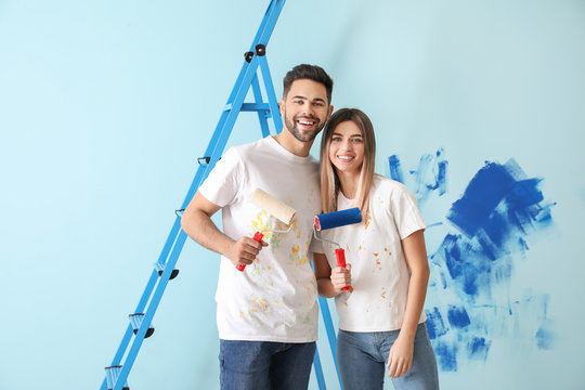 Happy young couple doing repair in their new house
