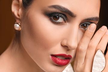 Wall Mural - Young woman with beautiful makeup, closeup
