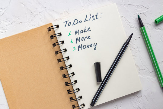 To do list - make more monTo do list - make more money written text on note pad. Close upe written text on note pad.
