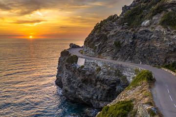 Wall Mural - Winding road along rocky coast