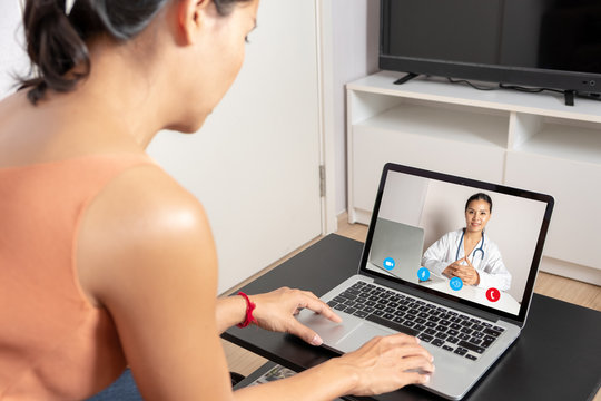 Woman using a laptop for a video call with a doctor