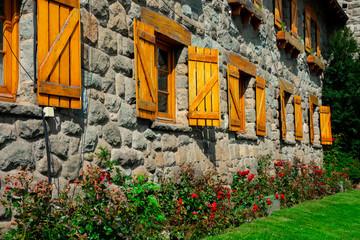 Papiers peints Amérique du Sud Wooden windows on Town Hall at Civic Center square (Centro Civico). Bariloche, Argentina