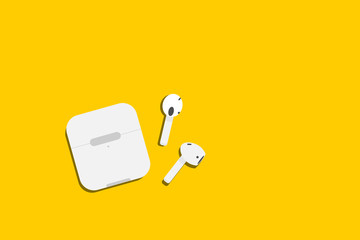 wireless earbud or airpod with basu box on yellow background.