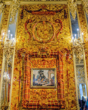 Gilded decorative elements on the amber wall of the newly renovated Amber Room (Amber Chamber) in the Catherine Palace of Tsarskoye Selo. Saint-Petersburg, Russia.