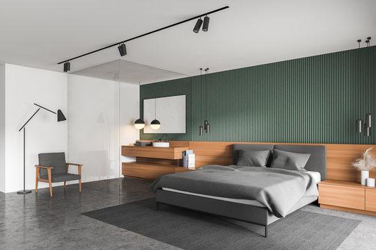 Green bedroom and bathroom corner with armchair
