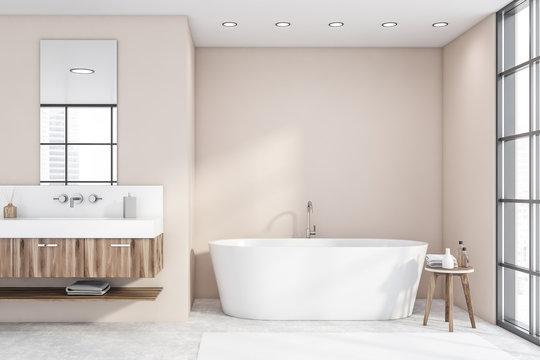 Tub and sink in loft beige bathroom