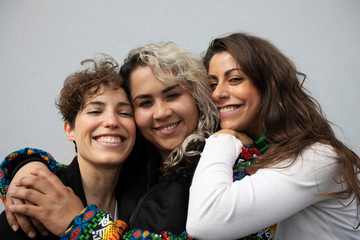 Songwriter Vivir Quintana, 36, poses with members of the female collective of Latin-American singers and authors 'El Palomar', who will sing a song against femicide at Zocalo square, in Mexico City