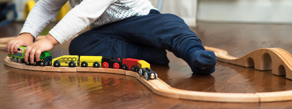 child playing with train toy