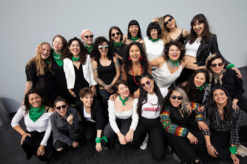 Songwriter Vivir Quintana, 36, and members of the female collective of Latin-American singers and authors 'El Palomar', who will sing a song against femicide at Zocalo square, pose for a picture in Mexico City