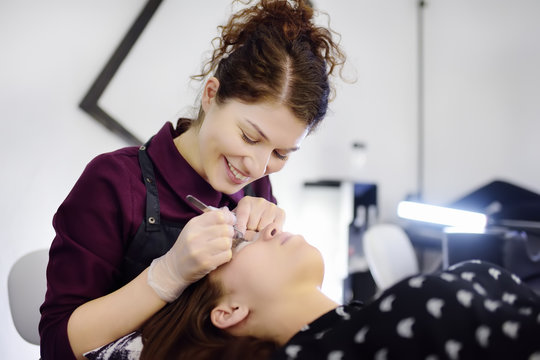 Beautician making eyelash lamination procedures. Modern eyelash care treatment procedures - staining, curling, laminating and extension for lashes.