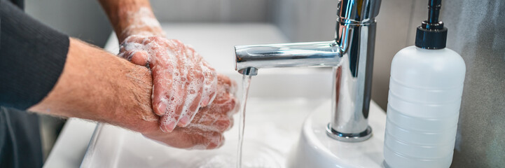 Corona virus travel prevention wash hands with soap and hot water. Hand hygiene for coronavirus outbreak. Protection by washing hands frequently concept panoramic banner header. Fototapete