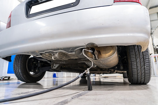 Emission control in the exhaust of an old car at a vehicle inspection station