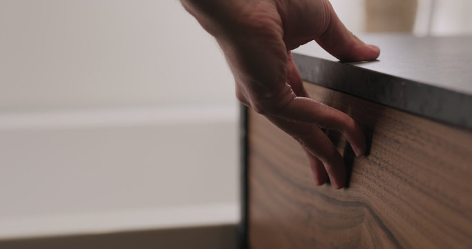 man hand open and close batroom cabinet drawer closeup