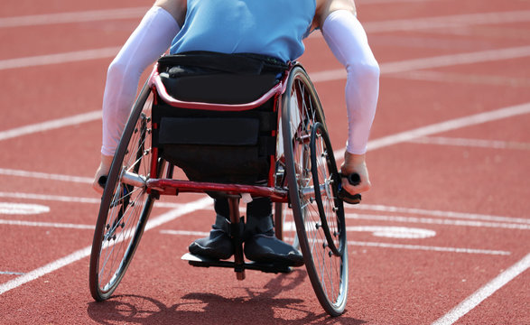 Paralympic athlete in a wheelchair with a paralysis in the legs