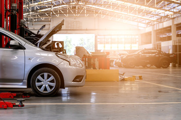 car in repair station and body shop with soft-focus and over light in the background