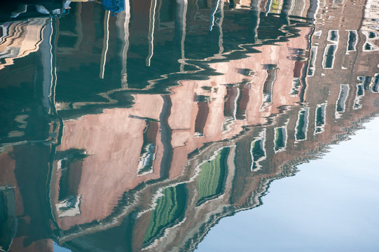 Buildings reflected on the water of one of the Murano canal