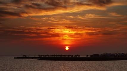 Fototapete - Resort beach with parasol and beautiful sea sunrise, 4k