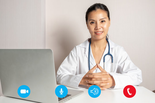 Woman doctor with a laptop for video call