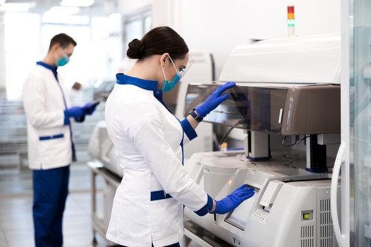 Female researcher doing molecular allergy diagnostics in laboratory
