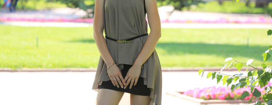 beautiful legs of a girl in a black mini skirt