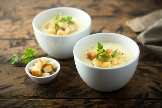 Homemade cheese soup with bread croutons