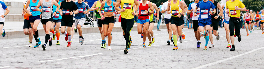 Fototapete - marathon runners running race in city a large group of athletes