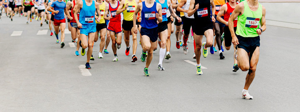 large group man runners running marathon on city street
