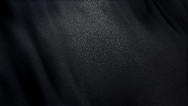 black flag cloth in full frame with selective focus. 3D Illustration of pitch-dark colored garment with clean natural linen texture for background banner or wallpaper use.