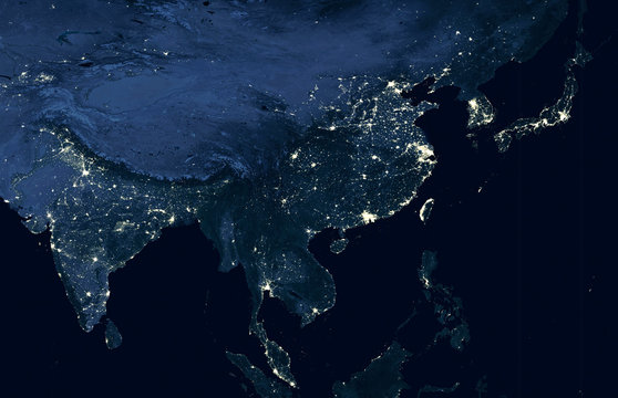 Earth at night, world map on satellite photo. City lights showing human activity in India, China, South Korea and Japan from space. Elements of this image furnished by NASA.