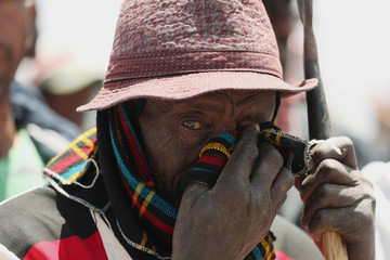 A man reacts during a memorial service for the victims of the Ethiopian Airlines Flight ET302 Boeing 737 Max plane crash near Bishoftu