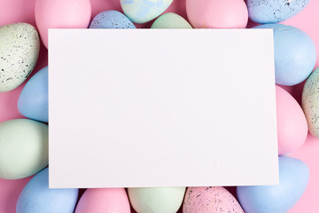Happy Easter greeting card from handmade painted colorful eggs and paper sheet for congratulation...