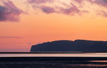 Foto op Aluminium Koraal Summer dramatic sunset in the westfjords of Iceland.