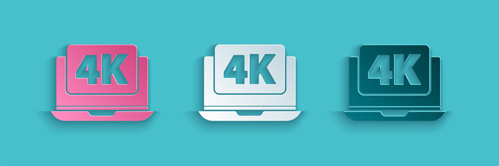 Paper cut Laptop screen with 4k video technology icon isolated on blue background. Paper art style. Vector Illustration