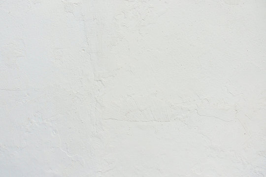 Abstract grunge white painted stucco wall texture background with copy space