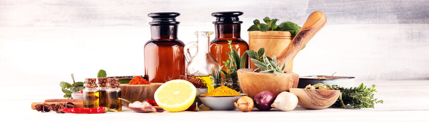 Fototapeta Spices and herbs on table. Food and cuisine ingredients with pepper obraz