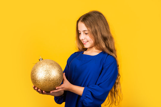 National colors of Ukraine. Blue and yellow. Shimmering glitter. Prepare decorations in advance. Girl hold golden ball decorations. Decorative accessories shop. Christmas decorations. Golden decor