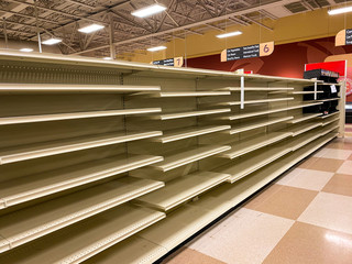 Empty Grocery Store Aisle With No Products Available After Sell Out