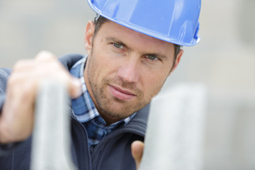 attractive and confident builder at a constructor site