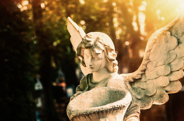 Fototapete - Sad angel with urn with dust as symbol of pain, fear and end of life. Ancient statue.