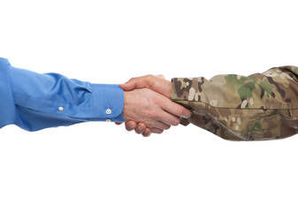 US Army soldier shaking the hand of a civilian businessman at a job interview that hires veterans.