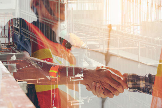 multi exposure of Shaking hands with congratulations on the construction investment agreement. Two construction engineers shake hands in construction site