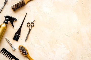 Beauty saloon accessories - combs, sciccors for hairdressing - on beige background top-down frame copy space