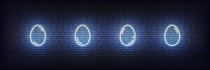 Easter eggs neon set. Glowing white linear eggs icons
